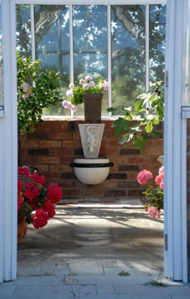 Vackra detaljer gör ditt växthus personligt och spännande. Foto: Vansta Trädgård