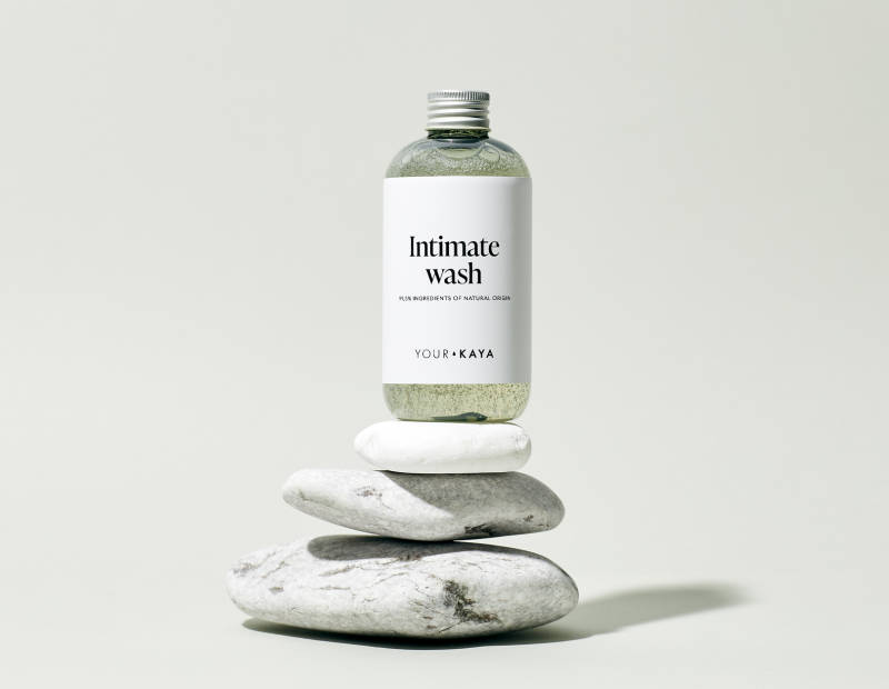 Your KAYA intimate wash in a composition with stones