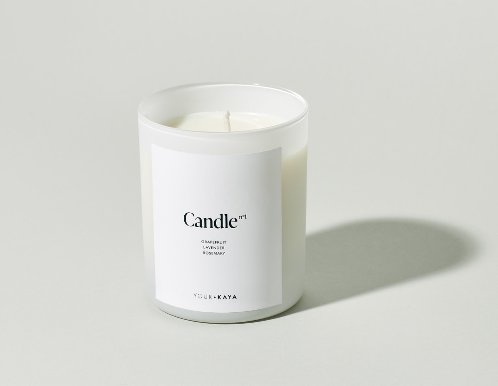 Your KAYA soy candle with a citrus and herbal scent