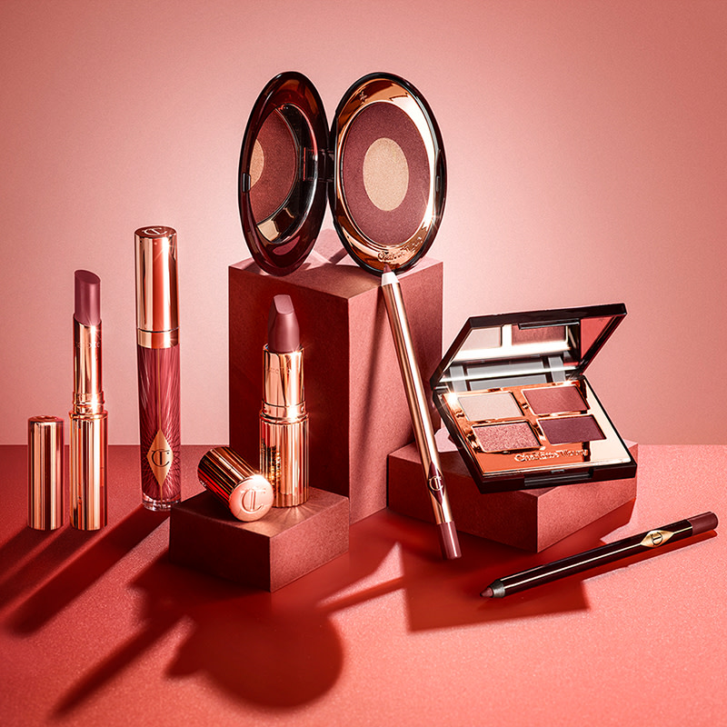 Walk of No Shame makeup collection still life including lip gloss, lipsticks, lip liner, eyeliner, blush and eyeshadow palette