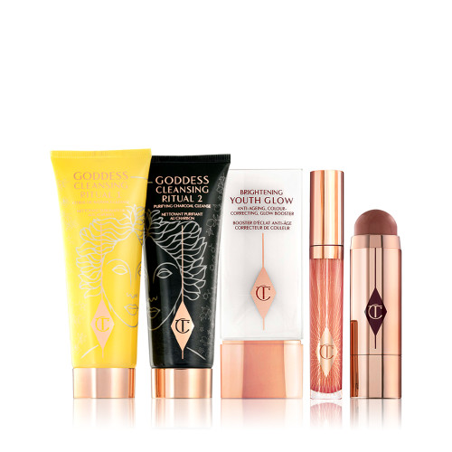 The Goddess Glow Kit Pack Shots including Goddess Cleansing Ritual charcoal mask and oil, collagen lip bath lip gloss, beach stick blusher stick and Brightening youth glow