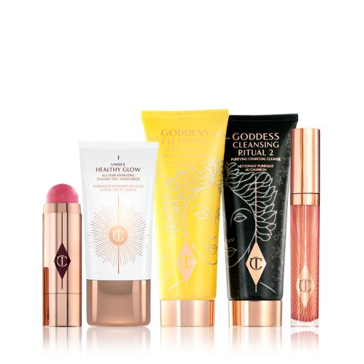 The Goddess Glow Kit Pack Shots including Goddess Cleansing Ritual charcoal mask and oil, collagen lip bath lip gloss, beach stick blusher stick and unisex health glow tinted moisturiser.