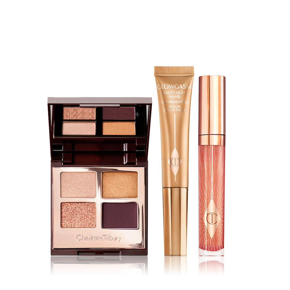 Save a magical 40%* on this makeup kit including a copper eyeshadow palette, golden liquid highlighter and peach lip gloss