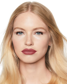 Charlotte Tilbury Matte Revolution Bond Girl Lipstick Lips model