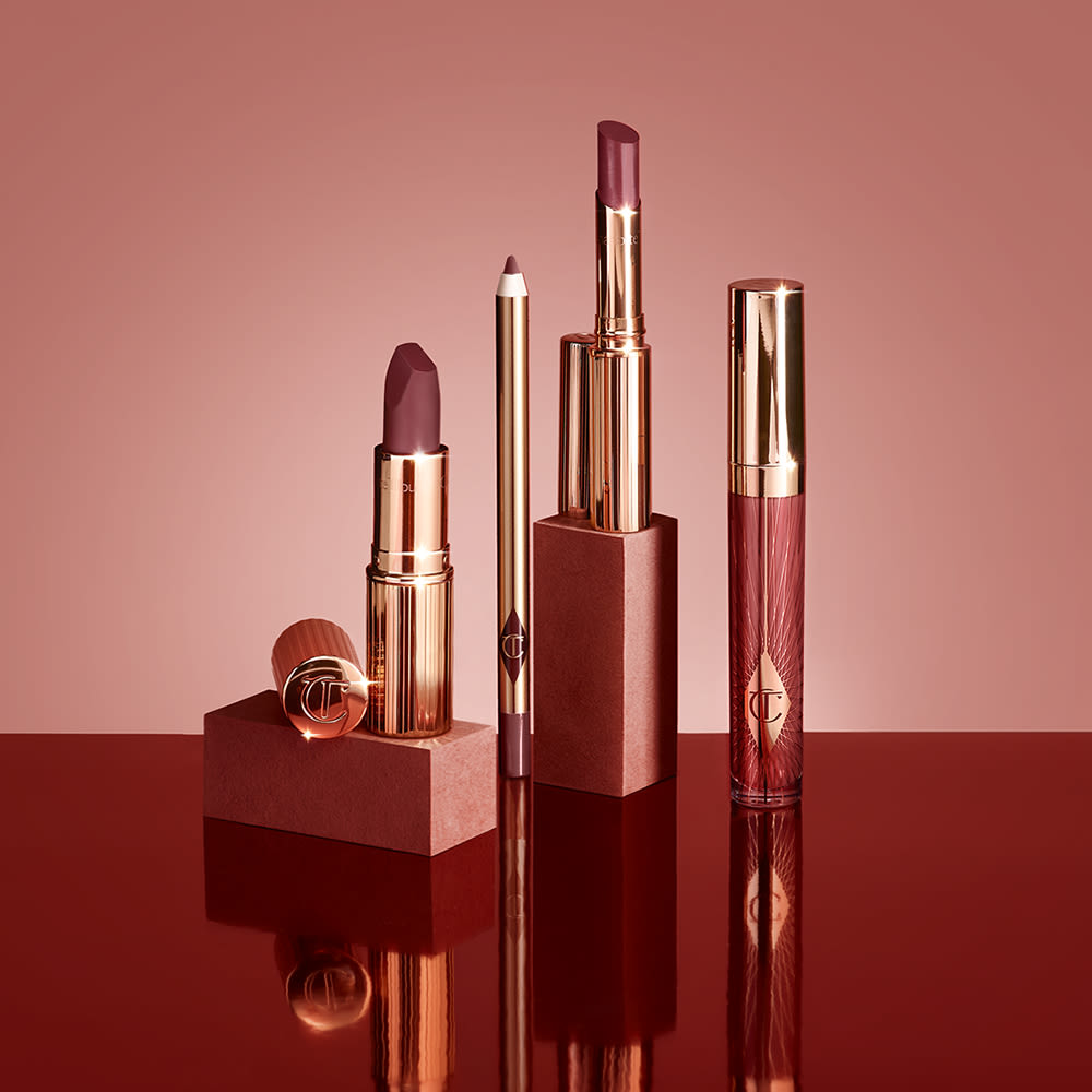 Walk of No Shame lip collection including berry lipstick, berry lip liner and berry lip gloss