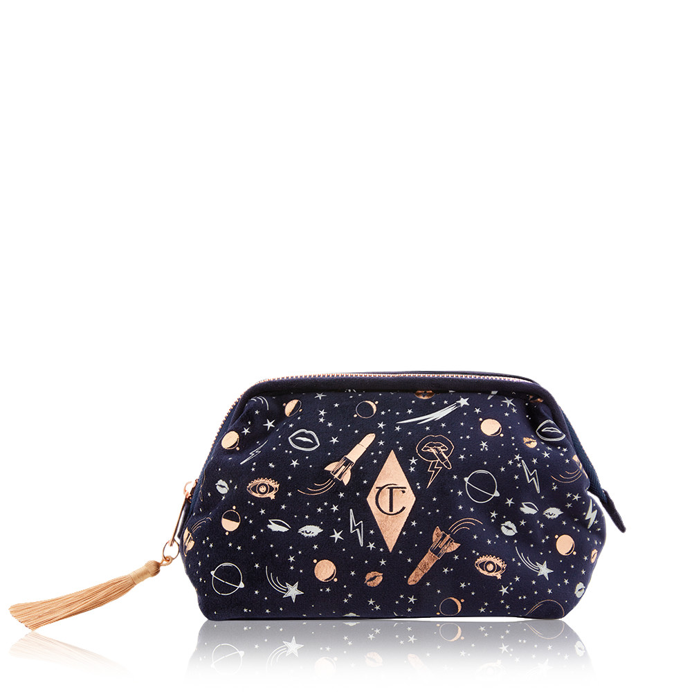 A luxurious makeup bag with a magical, celestial design!