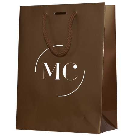 A brown coloured luxury paper bag available with a custom logo or image printed on the front at Helloprint