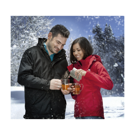 A couple enjoying a drink from a hip flask drinking bottle available at Helloprint with a custom logo printed on the front