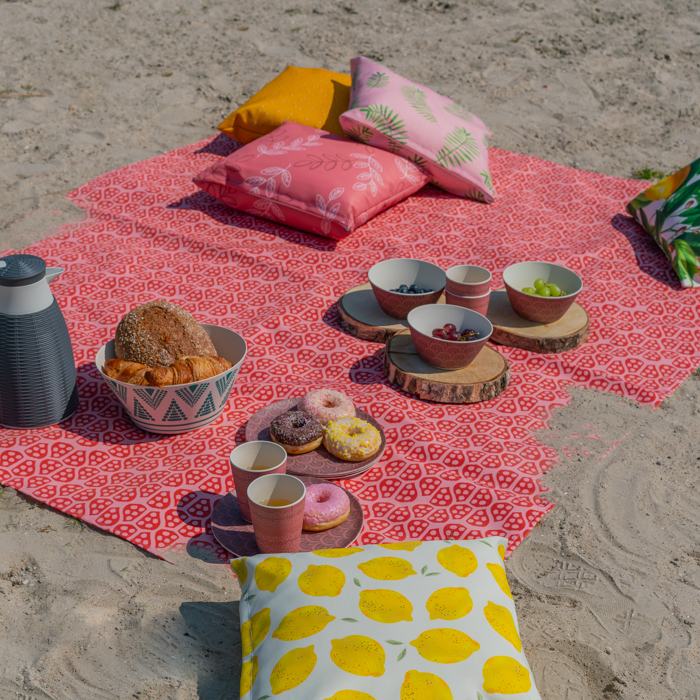 Image of a cheap picnic blanket on the beach. Print with your own design!
