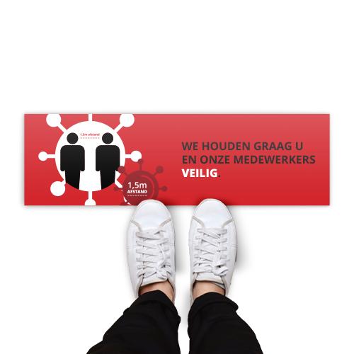 """Rechthoekige vloerstickers met rood achtergrond en met de tekst """"we houden graag u en onze medewerkers veilig""""."""