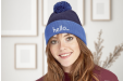 A woman wearing a custom printed beanie, available at Helloprint with personalised printing options for a cheap price