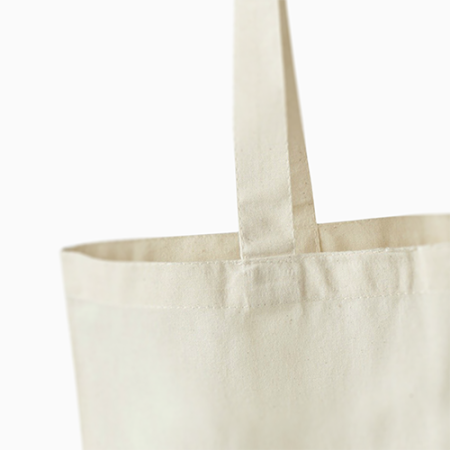 Example image of a cheap but high quality long handle cotton bag produced by Helloprint.