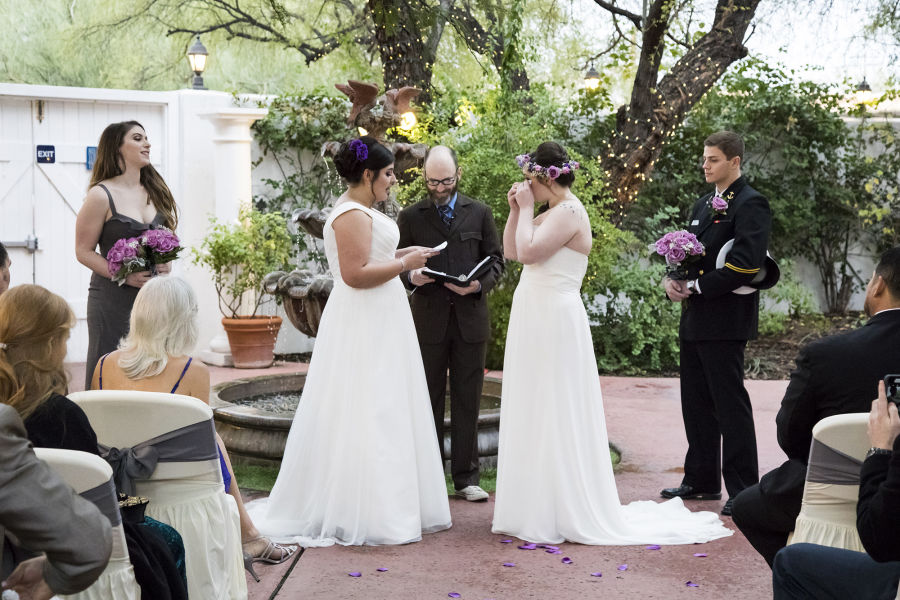 Two Brides Reading Vows