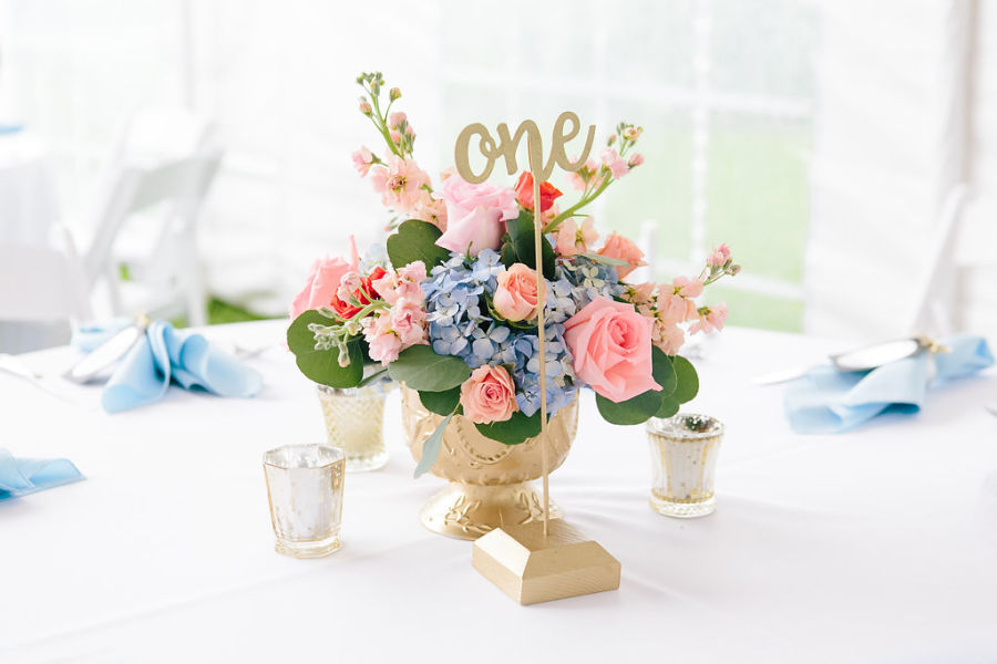 Wedding budget breakdown 101 how to divide conquer weddingwire pink and blue floral centerpiece with calligraphed table number junglespirit Image collections