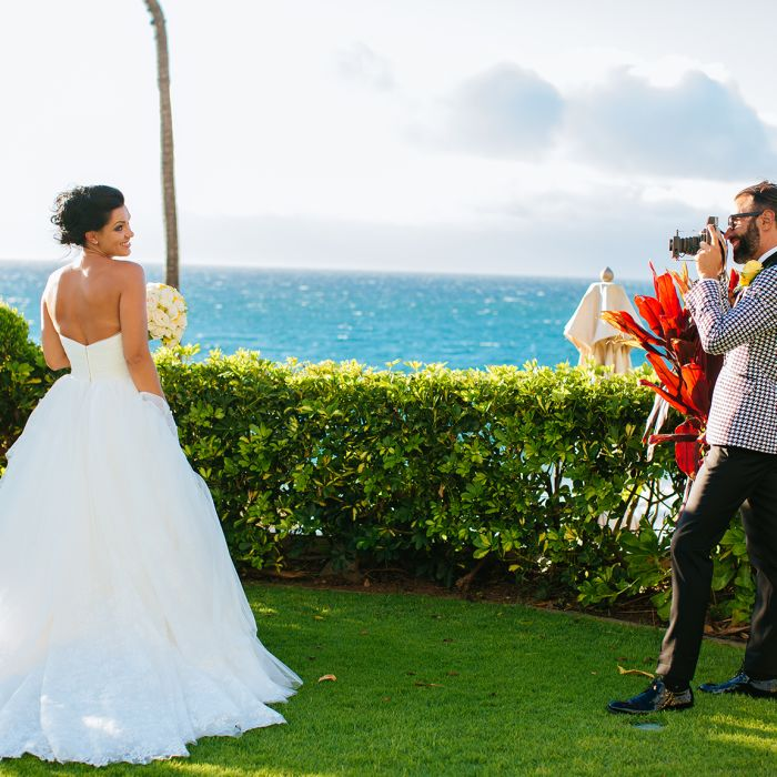 Groom Taking Photo Of Bride Photographer