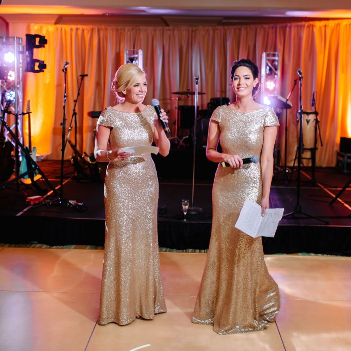 Two Bridesmaids Giving Speech At Reception