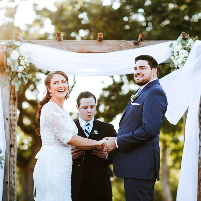 Couple At Altar Vows Outdoor Ceremony Kari Kriewald Sophisticated Whimsy Wedding Photos