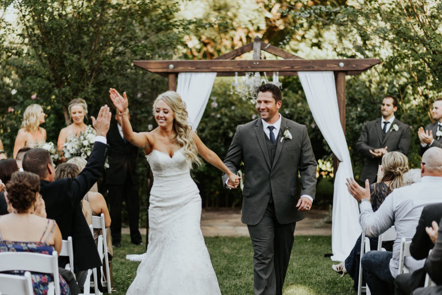 How to plan a surprise wedding weddingwire couple recessional high five junglespirit Gallery