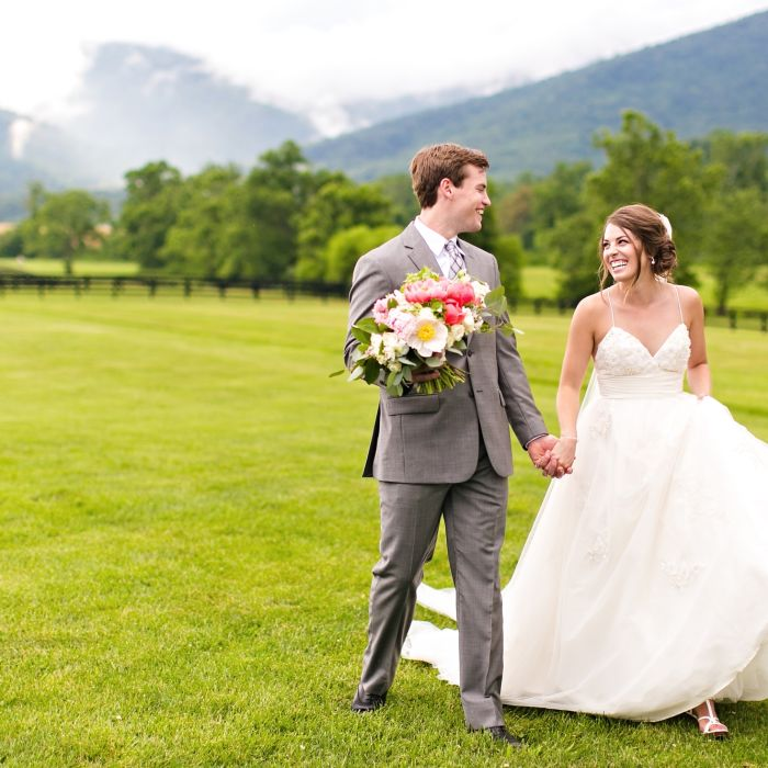 Wedding tipping guide weddingwire happy couple walking hand in hand junglespirit Image collections