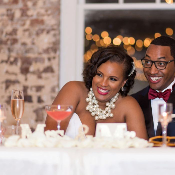 Couple At Reception Table Laughing