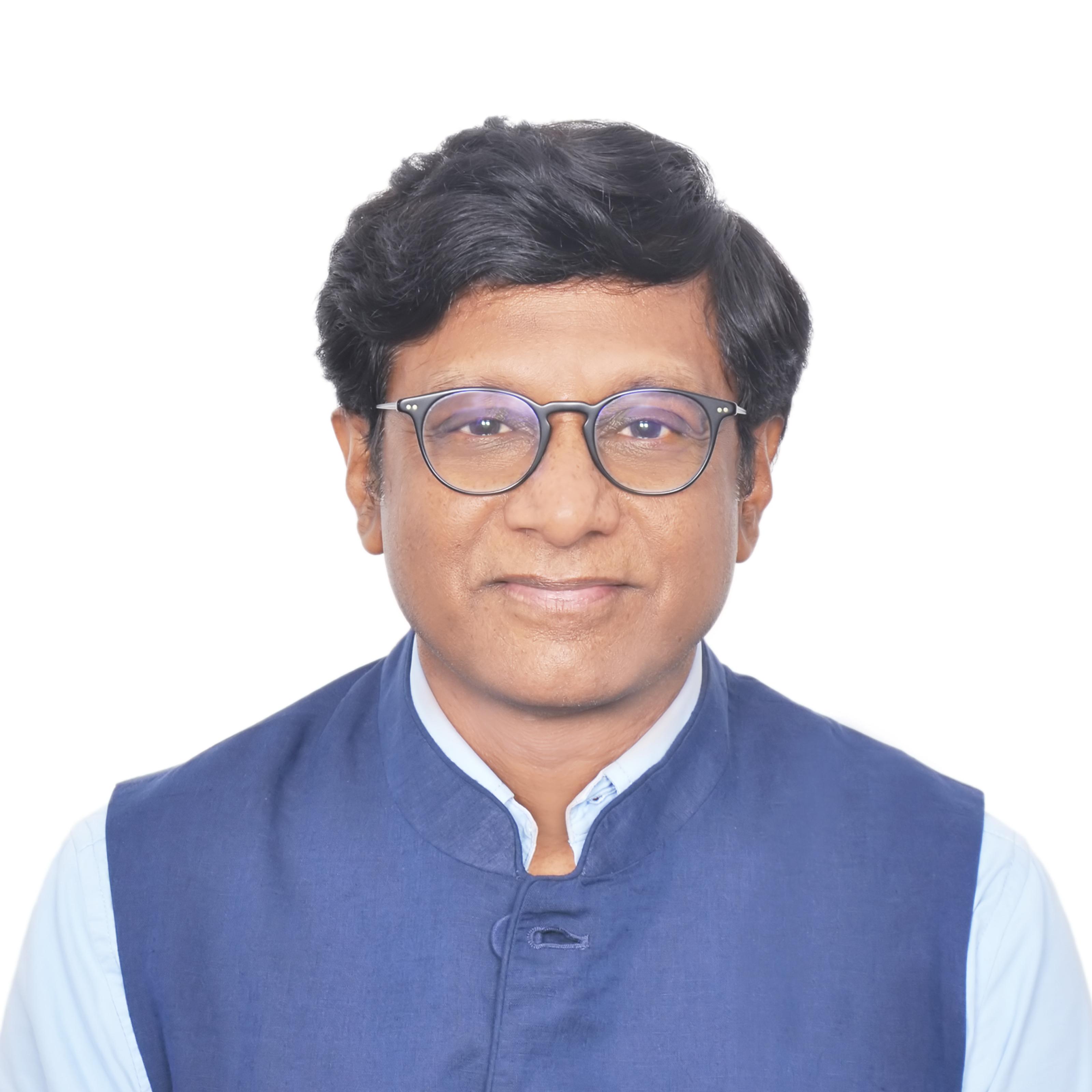 Former Ambassador / Dr. Mohan Kumar