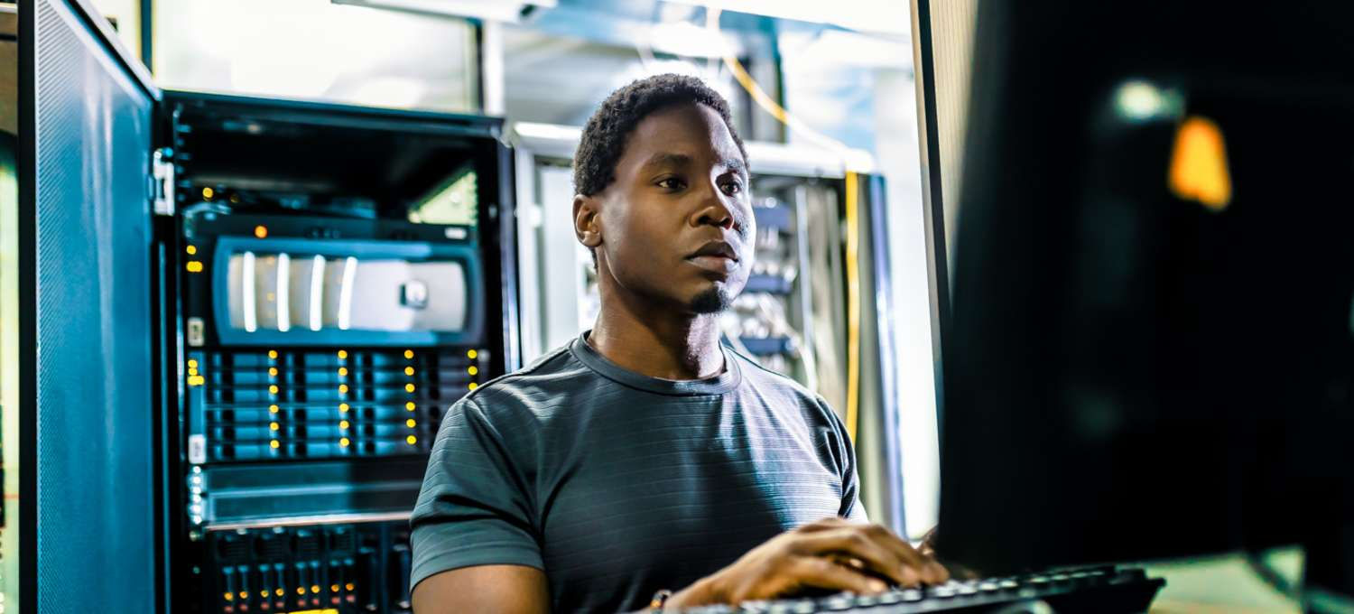An IT worker puts his CompTIA A+ certification to work