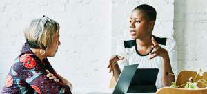 Project manager candidate interviews with her potential boss