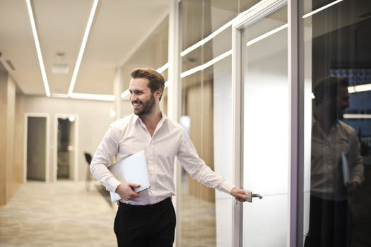formal guy smiling meeting room