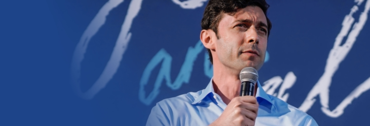 Jon Ossoff standing on stage