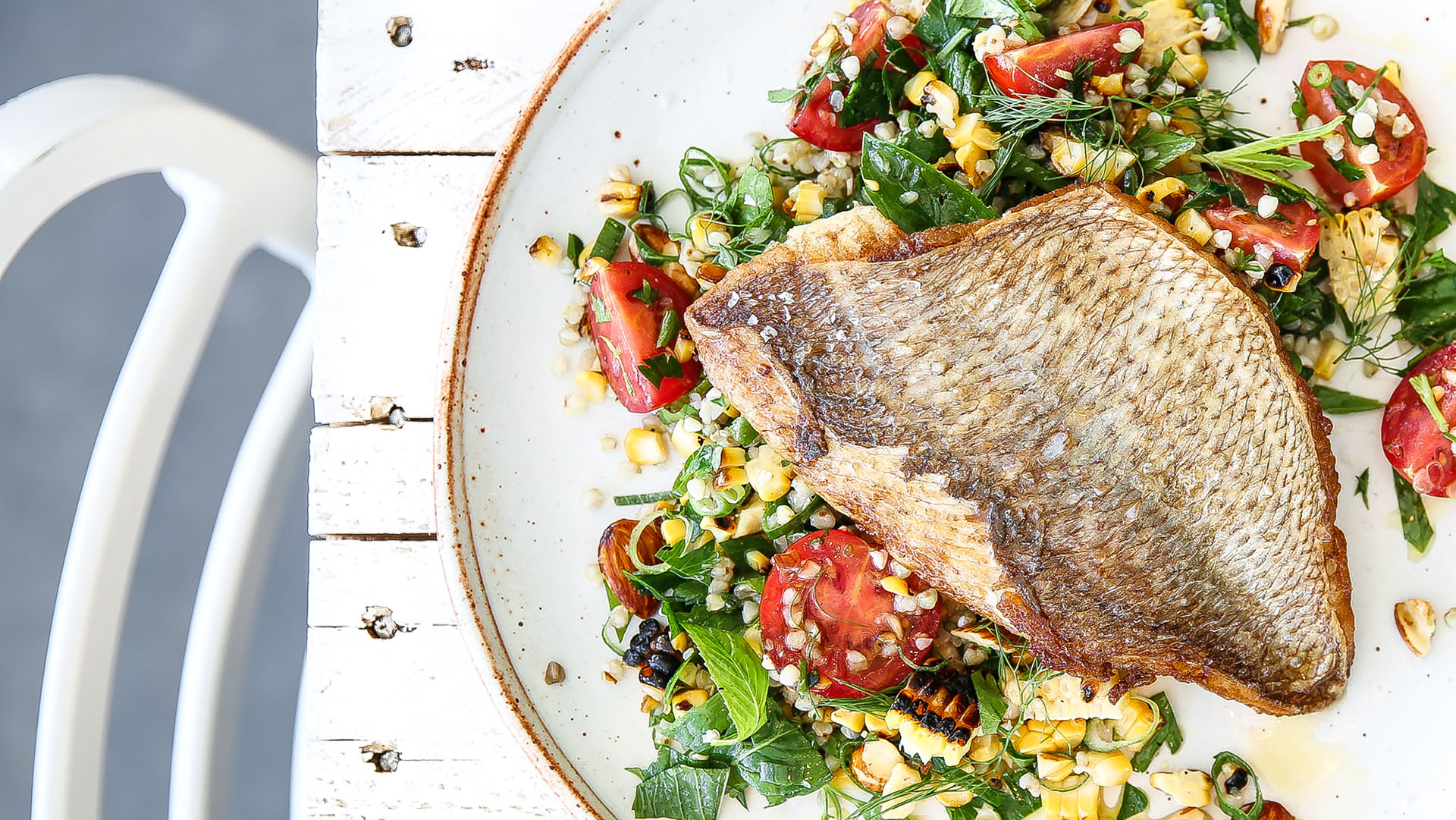 Grilled snapper, charred corn, almond and buckwheat tabouli recipe image