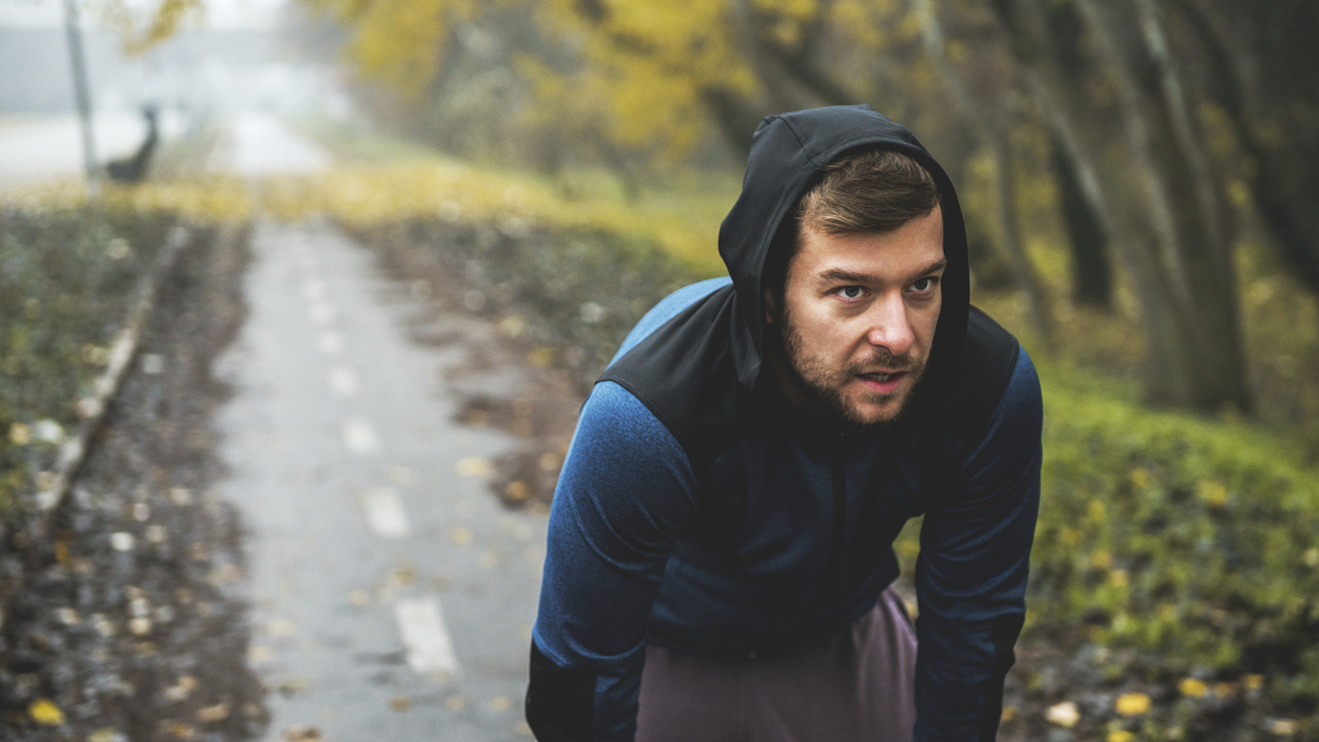 Shot of a man taking a break from running.