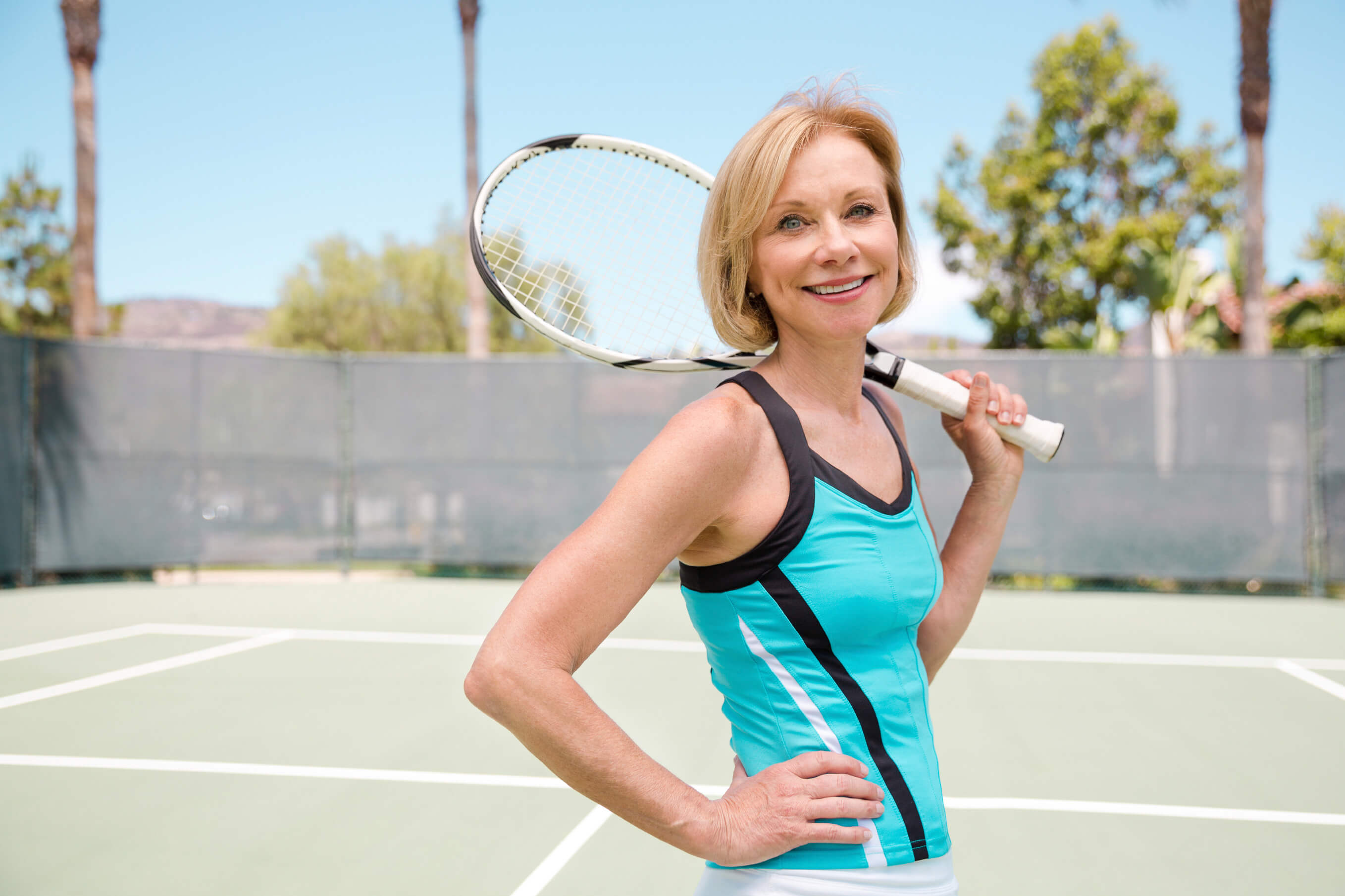 Active mature women playing tennis
