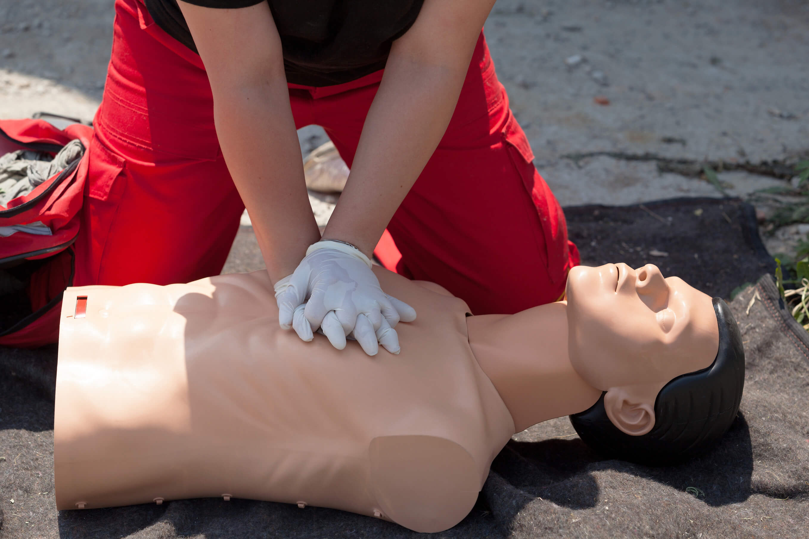 First aid training. CPR being performed on a medical-training manikin.