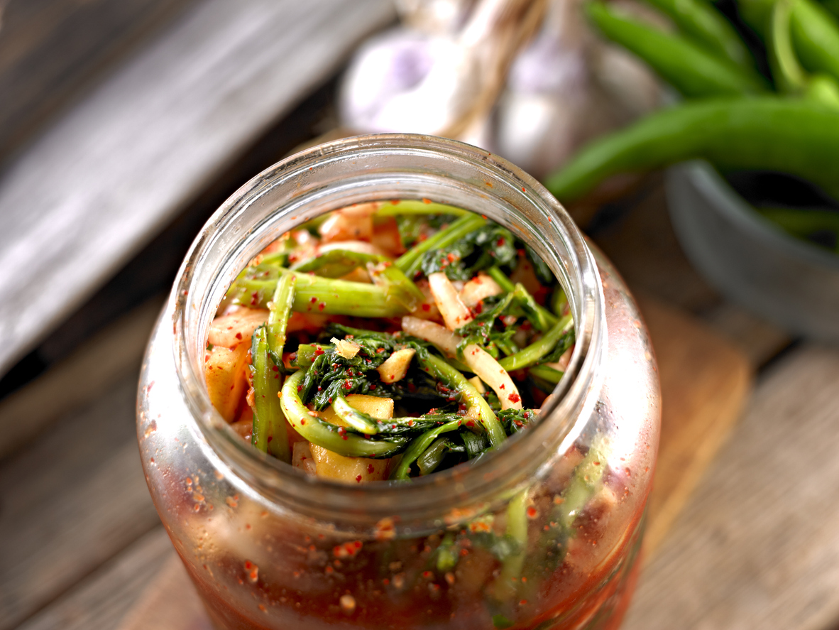 Kimchi made of Young Radish in Glass Bootle.