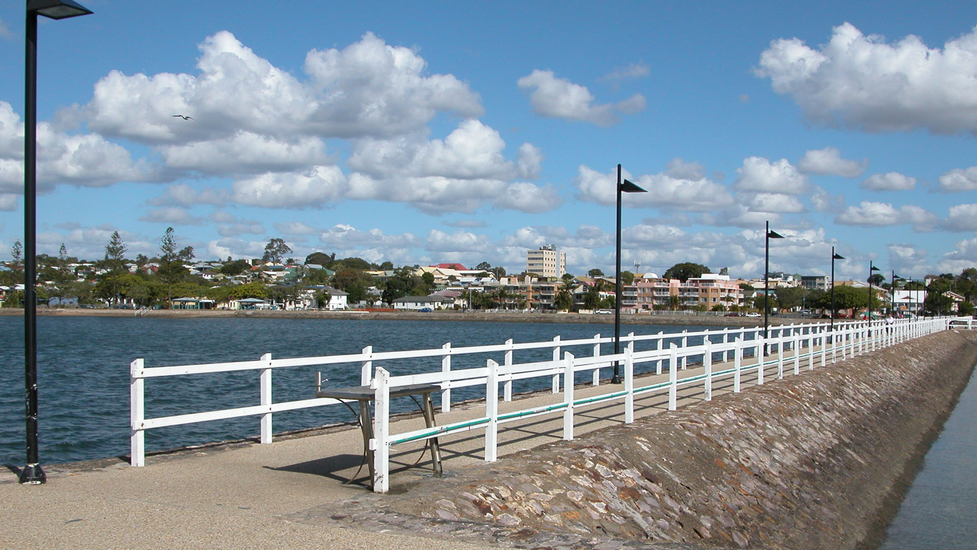 This long quiet jetty at Wynnum, Brisbane, Queensland, Australia is decorated with mosaic telling lore of the local Aboriginal people.