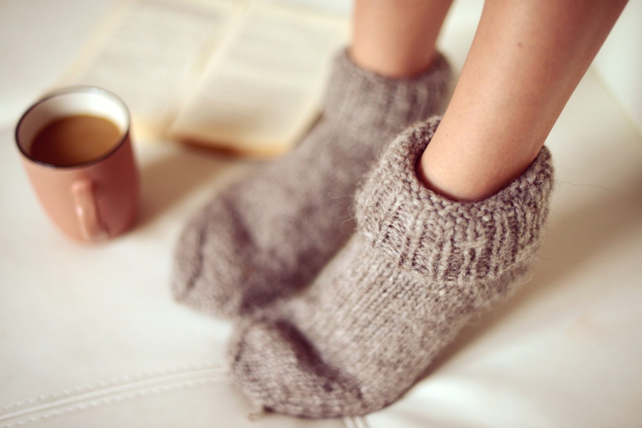female legs in woolen socks close up