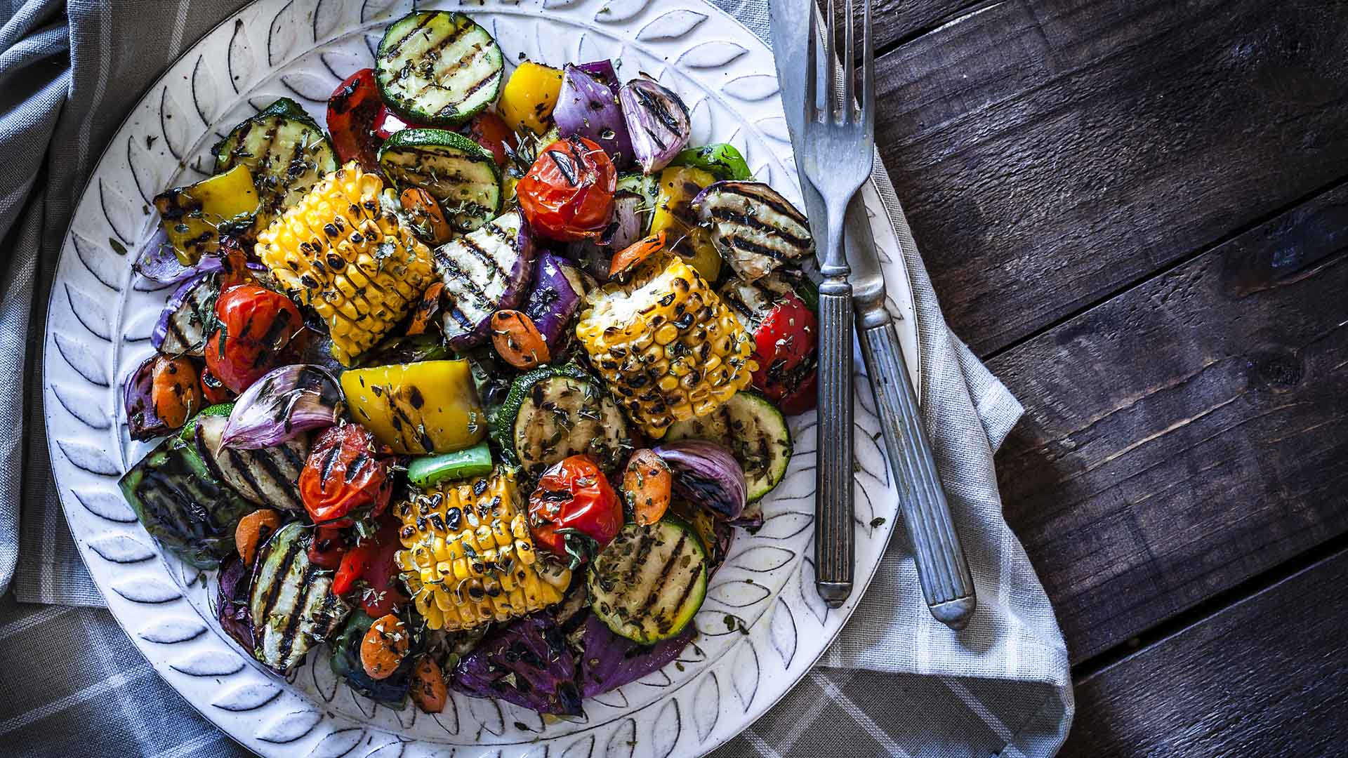 Grilled vegetables plate shot from above on rustic wooden table