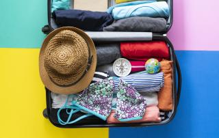 Open suitcase packed for a holiday