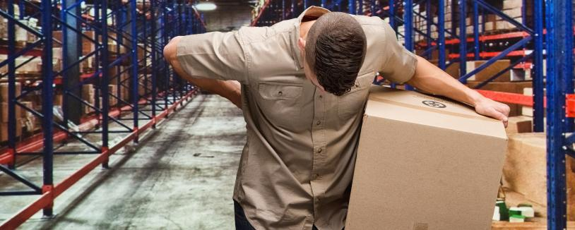 Man holding box in warehouse, holding his back