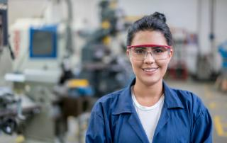Woman with googles on shop floor
