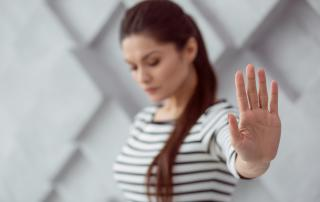 Woman holding up her hand as if to say stop