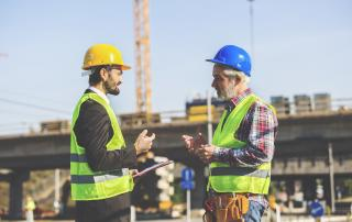 Two men talking at a construction site