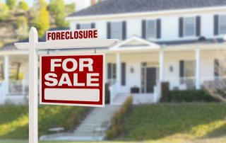 Foreclosure sign on house for sale