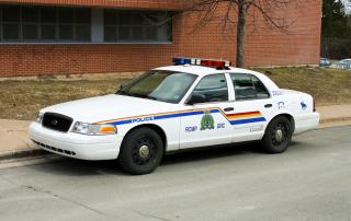 Empty RCMP vehicle parked on side of road