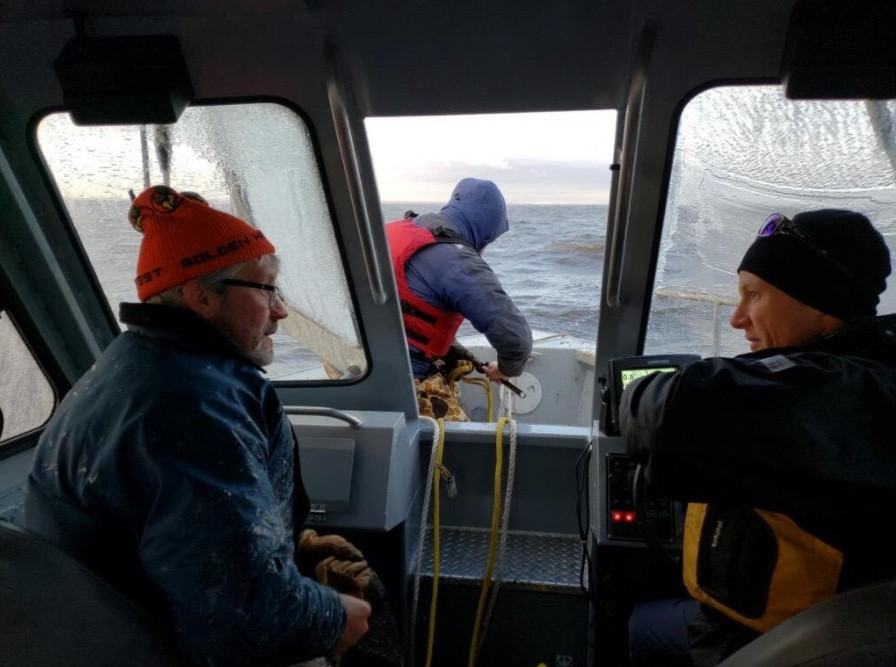 Research scientist Shane Bowe, Red Lake DNR, Mark Edlund and Adam Heathcote traveling on a boat.