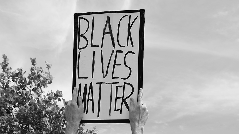 Protestor's hand-written sign that reads Black Lives Matter.