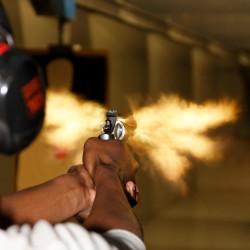 magnum revolver being fired at shooting range SHT