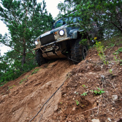 jeep offroading in the dirt with 4x4 SHT