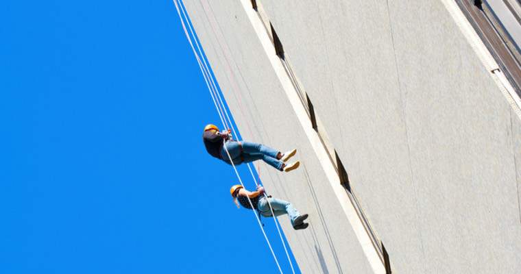 House Running abseiling off building in Berlin