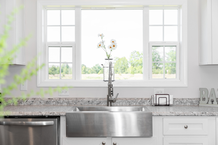 76CBG32764AM, Lux window in the kitchen of a manufactured home.